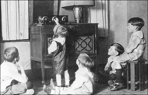 children-listening-to-radio